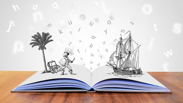 picture of an open book with a pirate and a pirate ship drawn on top of it and letters scattered around them